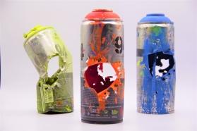 Ellion Cardoso, Fogo Cruzado, 2016. Latas de spray furadas com cartuchos de espingarda calibre 28, 7 x 18 cm
